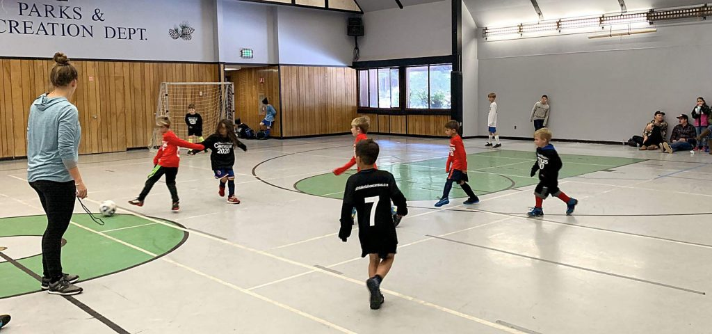 Kids play indoor soccer with new jerseys purchased by the El Dorado County Foundation.