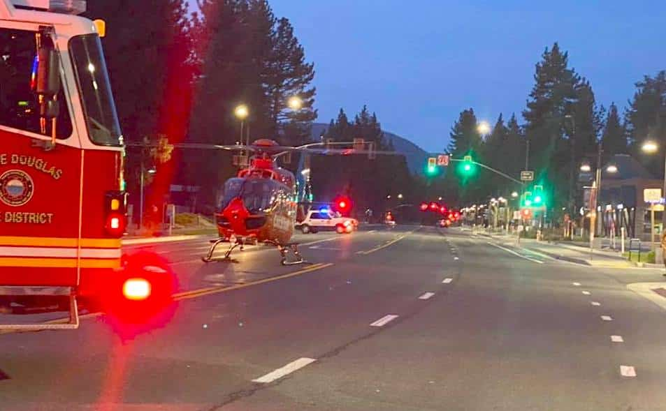 A CalStar helicopter lands on Lake Tahoe Blvd., to transport the injured motorist.