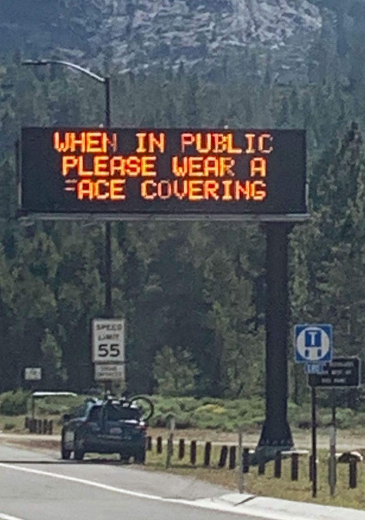 A sign in Meyers, Calif. asks people to wear a mask while in public.