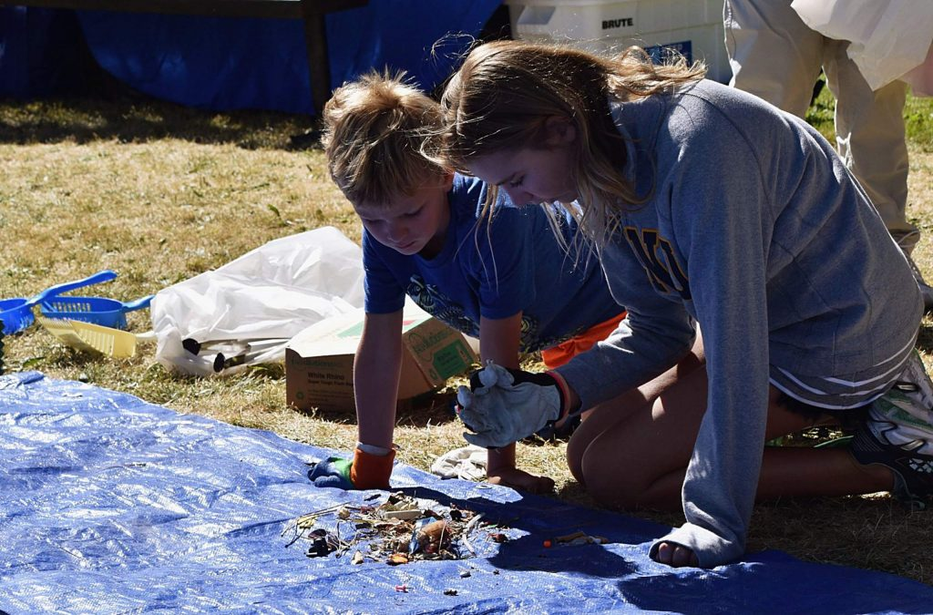 Maia and Rowan Edmonds participate in clean up days with their mom.