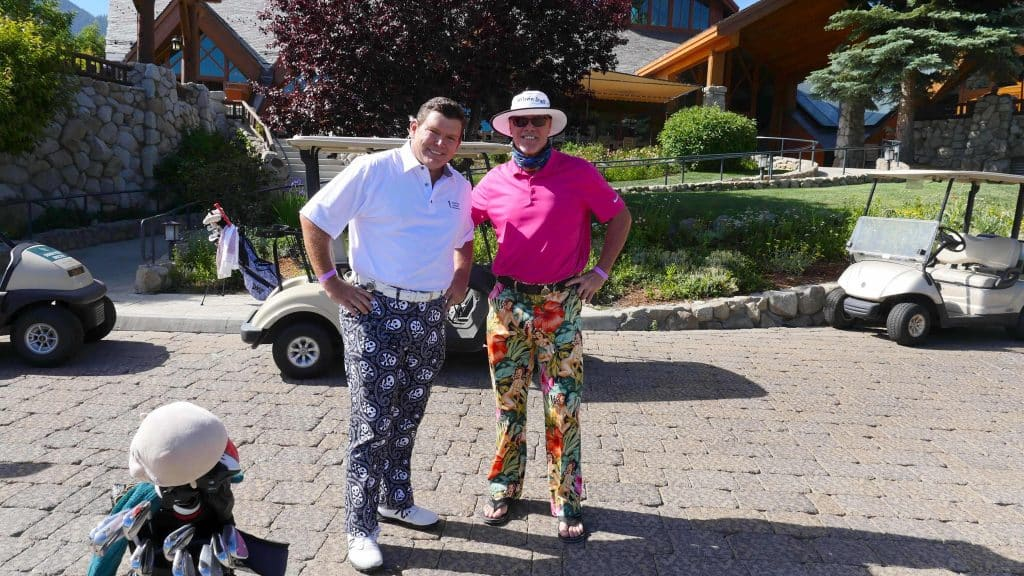 Bret Baier (left) and Jim McMahon pose for a photo before the first round.