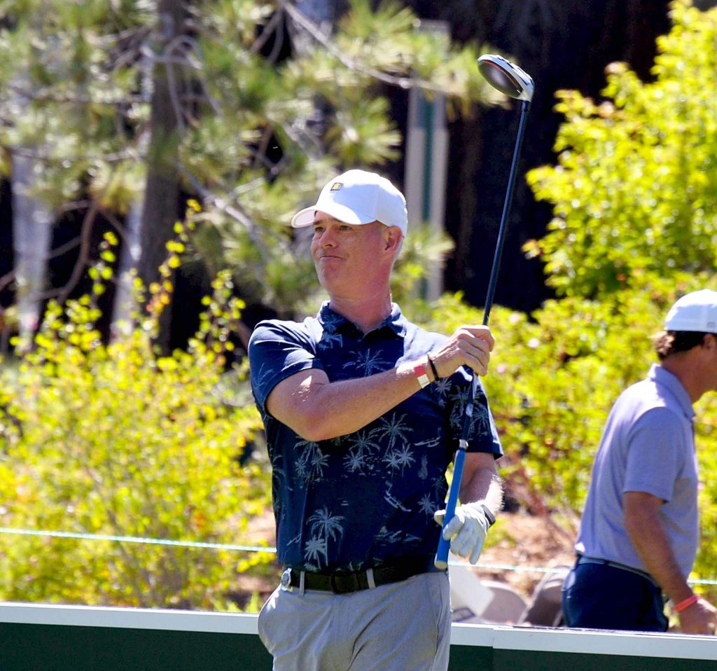 Joe Buck watches the flight of his ball during a practice round.