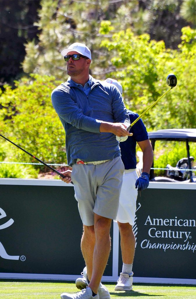 Former champion Mark Mulder hits during a practice round.
