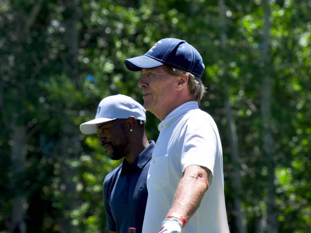 Former ACC champion Jack Wagner stands at a tee box with Jimmy Rollins.
