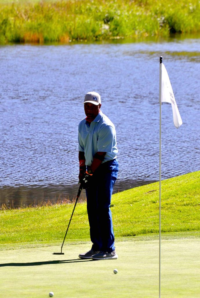 MLB Hall of Famer Ozzie Smith works on his putting Thursday.