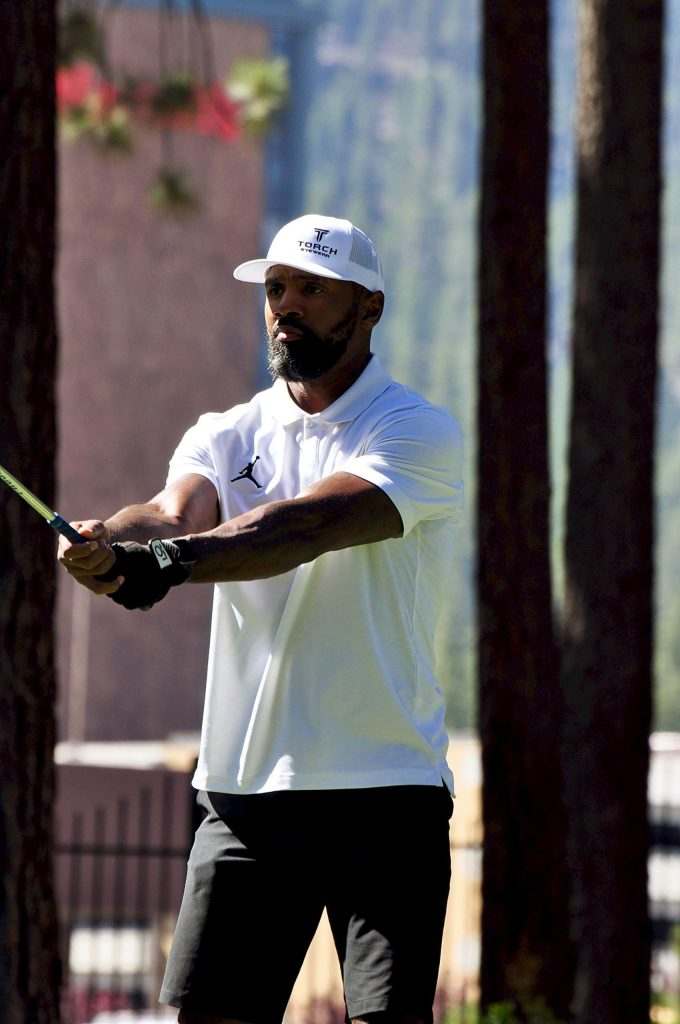 Former NFL great Charles Woodson gets ready to hit.