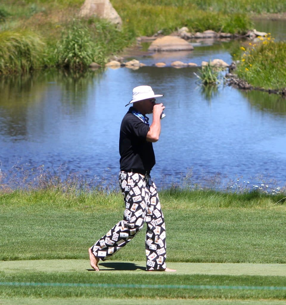 Jim McMahon strolls along the par 3 12th hole.