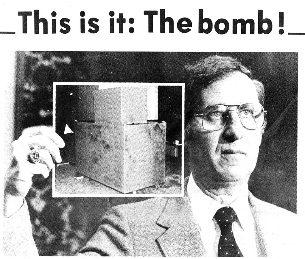 Joseph Yablonsky, special agent in charge of the FBI's Las Vegas office, holds up a photo of the bomb taken by Douglas County sheriff's deputies after it had been dusted for fingerprints.