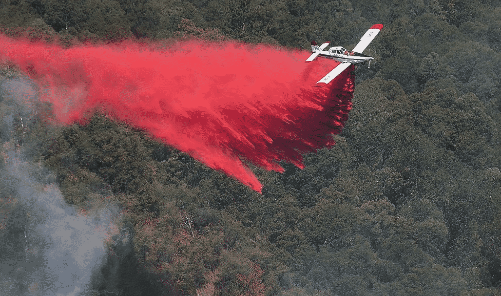 A single engine air tanker drops a load of retardant on Monday.