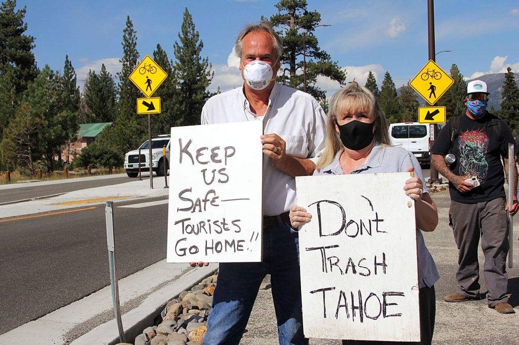 Protestors held signs as motorists entered South Lake Tahoe on Aug. 14.