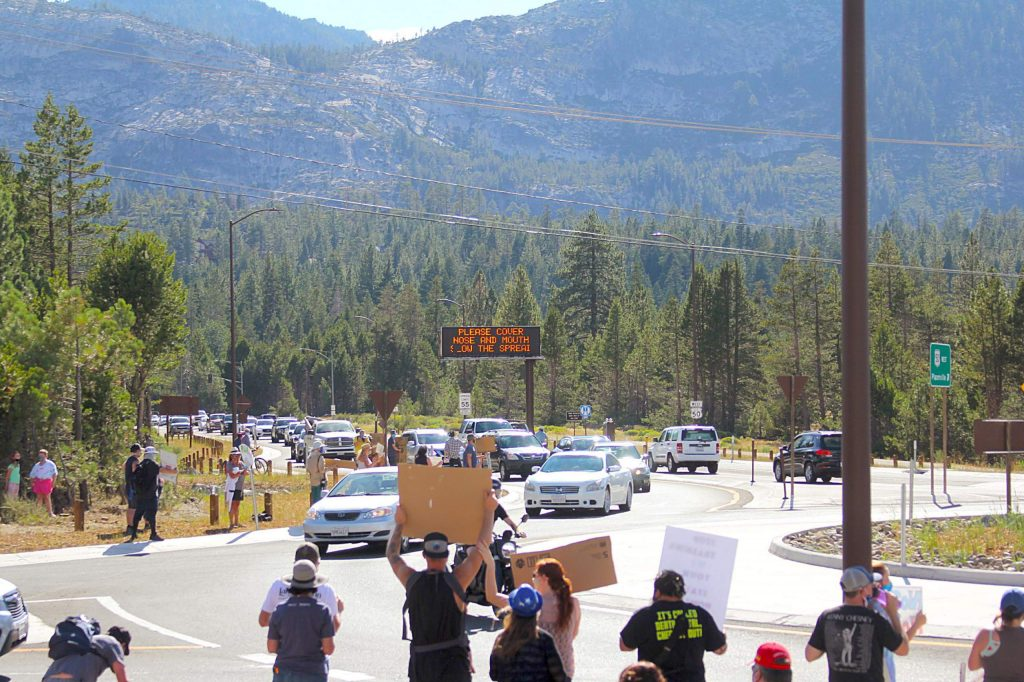 Protestors in Meyers at the roundabout held signs for incoming traffic.