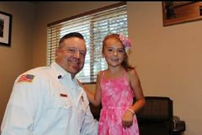 Chief Brady was pinned by his daughter, Arie.
