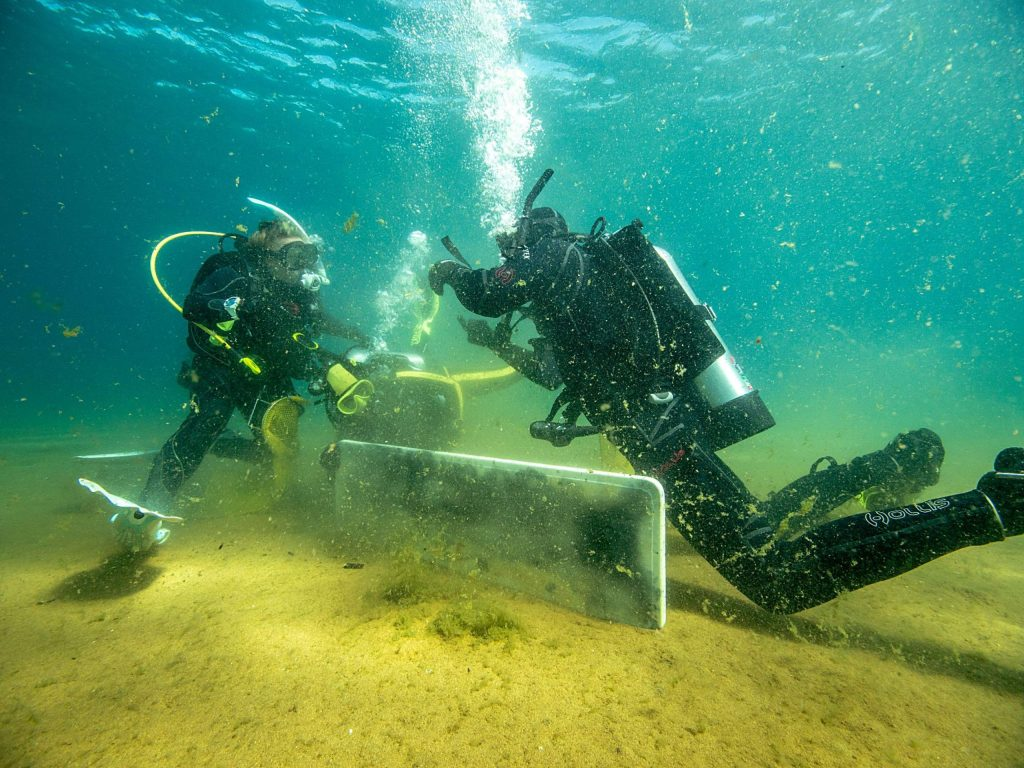 Divers picked up trash below the surface in several places incuding Nevada Beach.