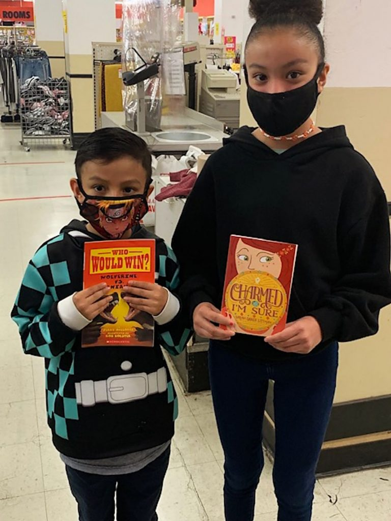 Two students with new books.