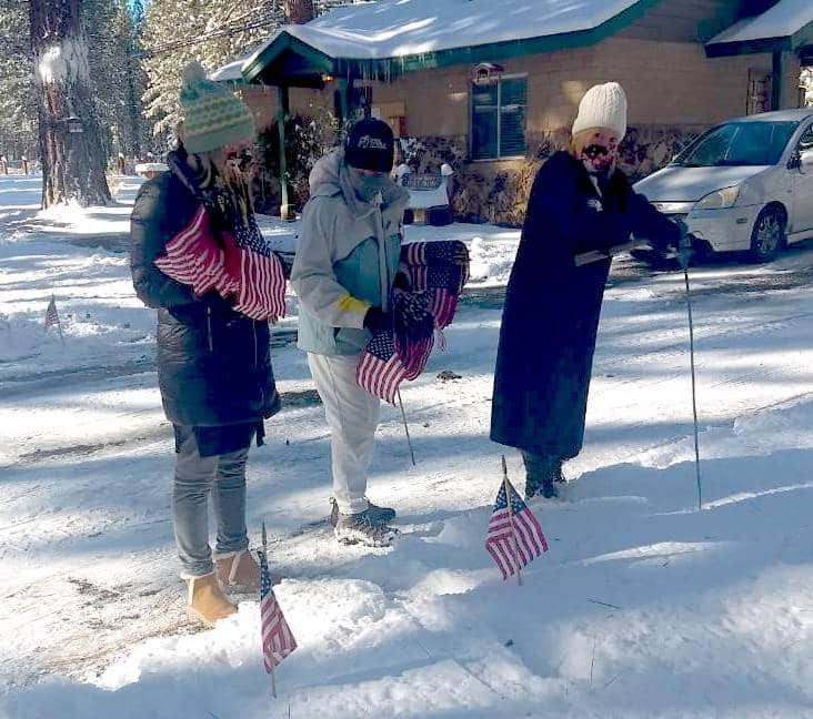 Daughter of the American Revolution, Lake Tahoe Chapter volunteers (pictured from left) Chaplain Dawn Hill, Regent Rosemary Manning and Registrar Carrie Champness plant flags on Monday at Happy Homestead Cemetery.