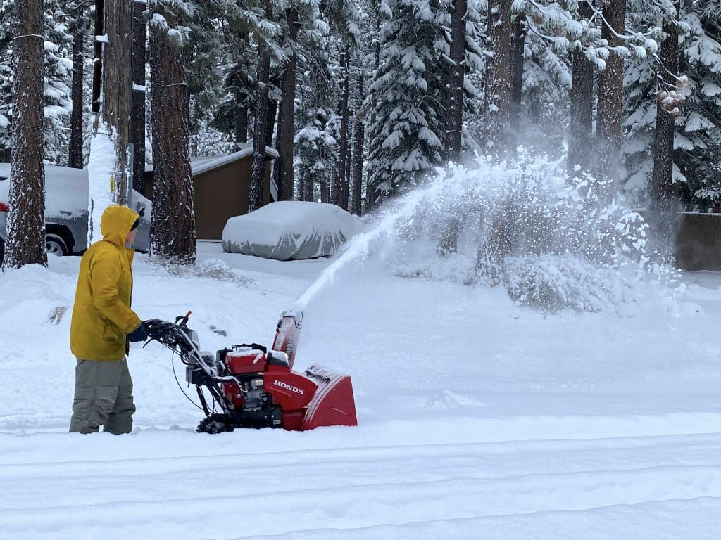 A South Lake Tahoe resident clears snow Sunday morning.