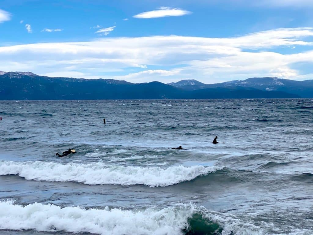 Surfers check out the waves Tuesday on Lake Tahoe's North Shore.
