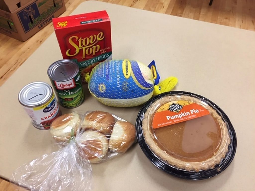 The bags included dairy, bread, fruits, vegetables, turkey breast, stuffing, cranberry sauce, green beans, rolls, cider and pie.